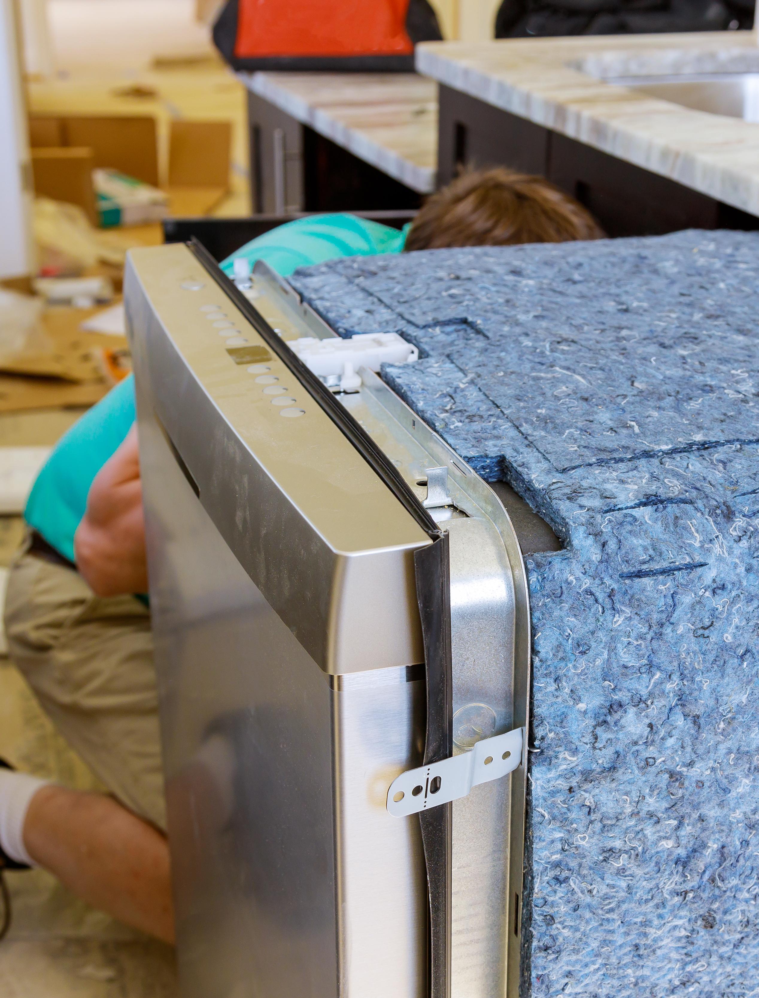 plumber-repair-in-the-household-dishwasher-machine-NZK8YMY